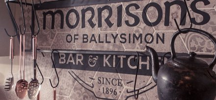 Hexagonal cement tiles and wood-effect stoneware in a historic Irish pub